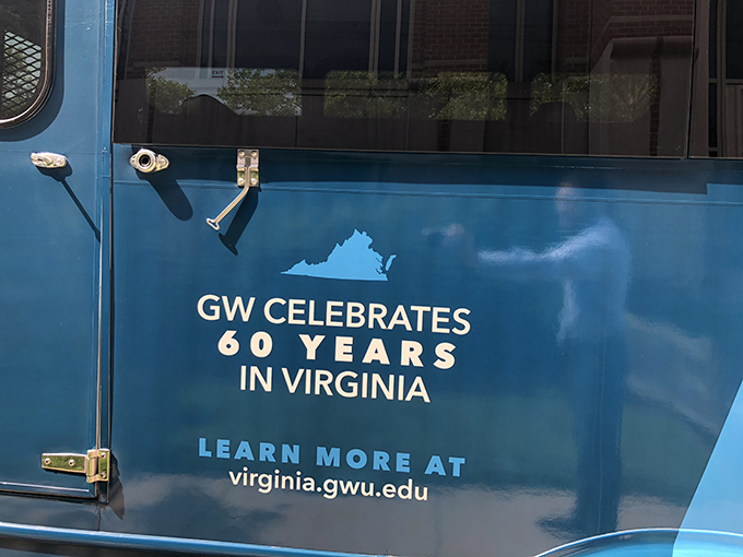"Painted bus says ""GW Celebrates 60 Years in Virginia, Learn more at virginia.gwu.edu"""