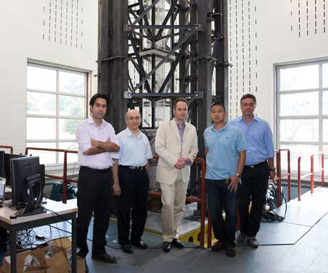 GW research team pictured in front of the model on the shake table