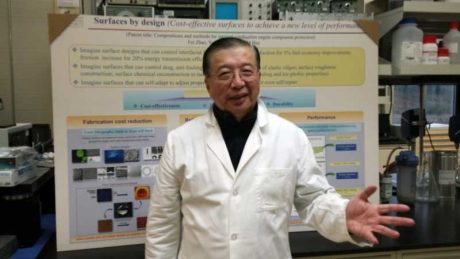 Prof. Hsu and research poster
