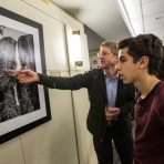 Reception guests examine photographs by Frank Ruggles