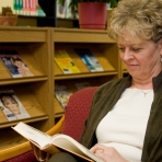 woman visiting library reading