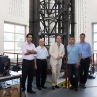 research team in front of model