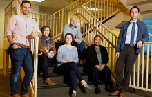 Instructional design team by staircase