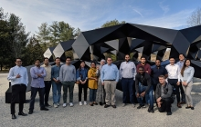 A group of IIST bachelor's degree completion program students in front of a sculpture at Glenstone art museum