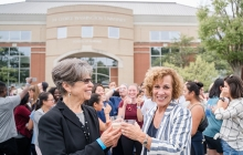Dean Jeffries toasting in front of Innovation Hall, now the School of Nursing