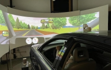 driving simulator car with simulated driving environment on the screen