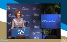 Dean Jefferies at podium with GW logo