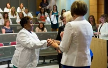 Nursing student shakes dean's hand